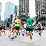 Participants running past Marina Towers