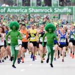 Green Guys and runners at the start line